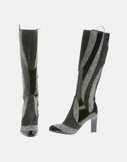 More information or Buy online WOMAN - ALEXANDER MCQUEEN - FOOTWEAR - BOOTS - AT YOOX