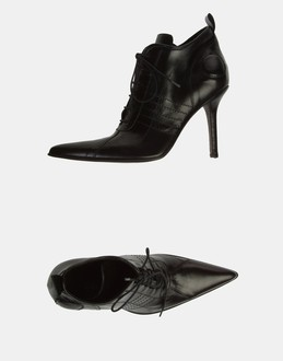 More information or Buy online WOMAN - SARA & CO - FOOTWEAR - ANKLE BOOTS - AT YOOX