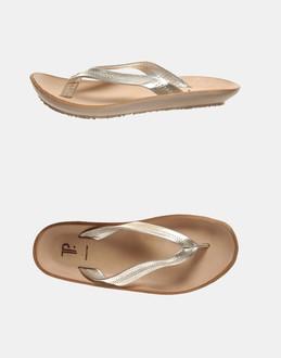 More information or Buy online WOMAN - TP - FOOTWEAR - FLIP FLOPS - AT YOOX
